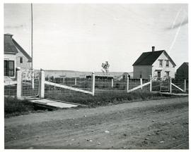 Castalia, Dr.MacAulay's fence, two gates, part of house and barn at left.John Graham house at rig...