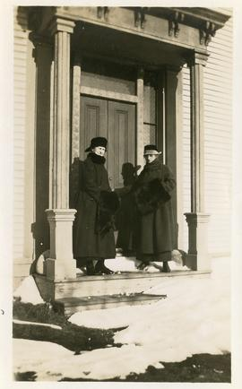 Grace Newton, on left, 21 March 1920, with a second lady, standing on the front step of a house (...