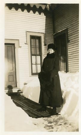Grace Newton, 21 March 1920, standing on a walkway to the door at the back of a house (Dale Brown...